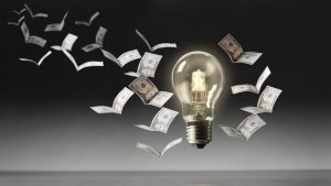 Bulb with cash background flying away like birds